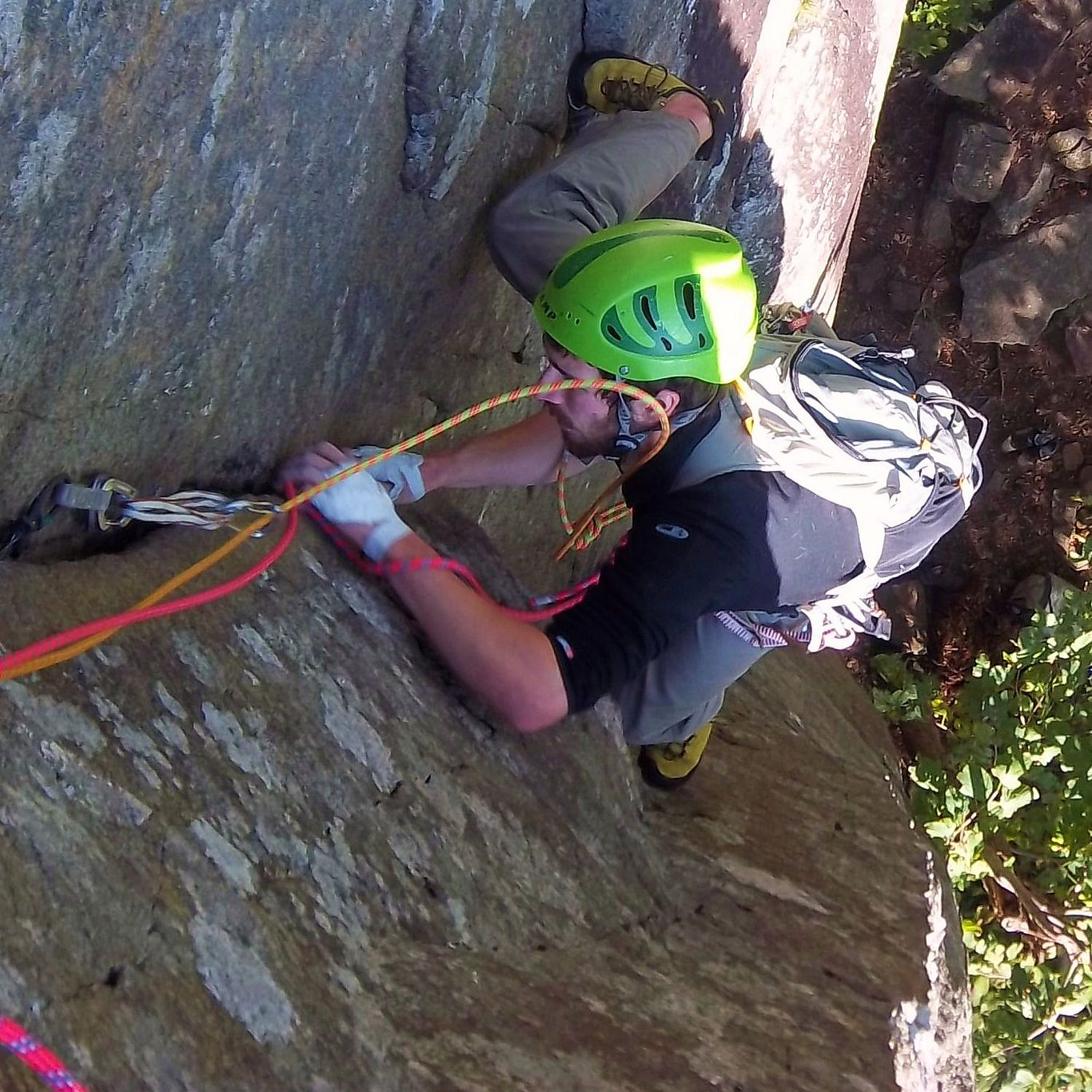 A rock climber stemming up a corner